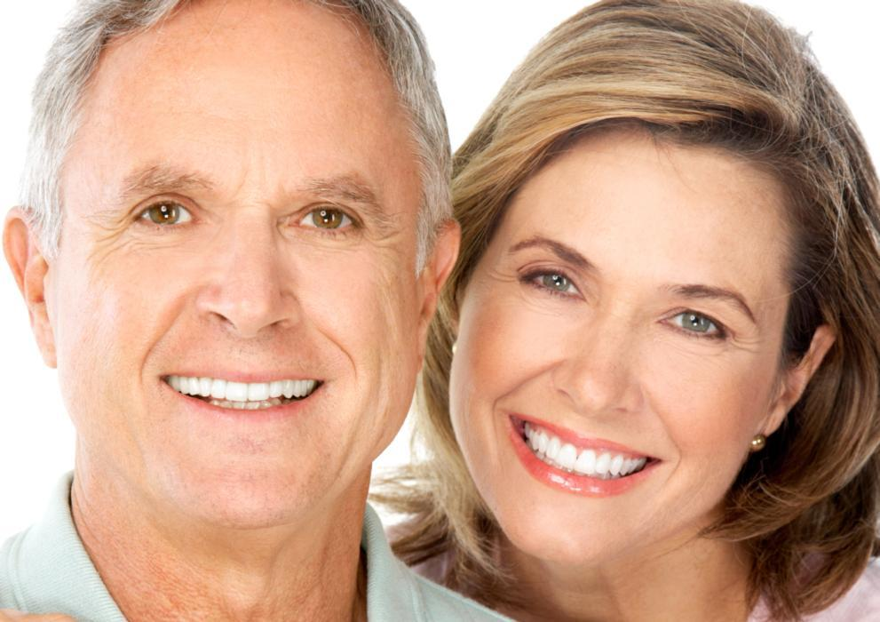 Older man and woman with snap on smiles