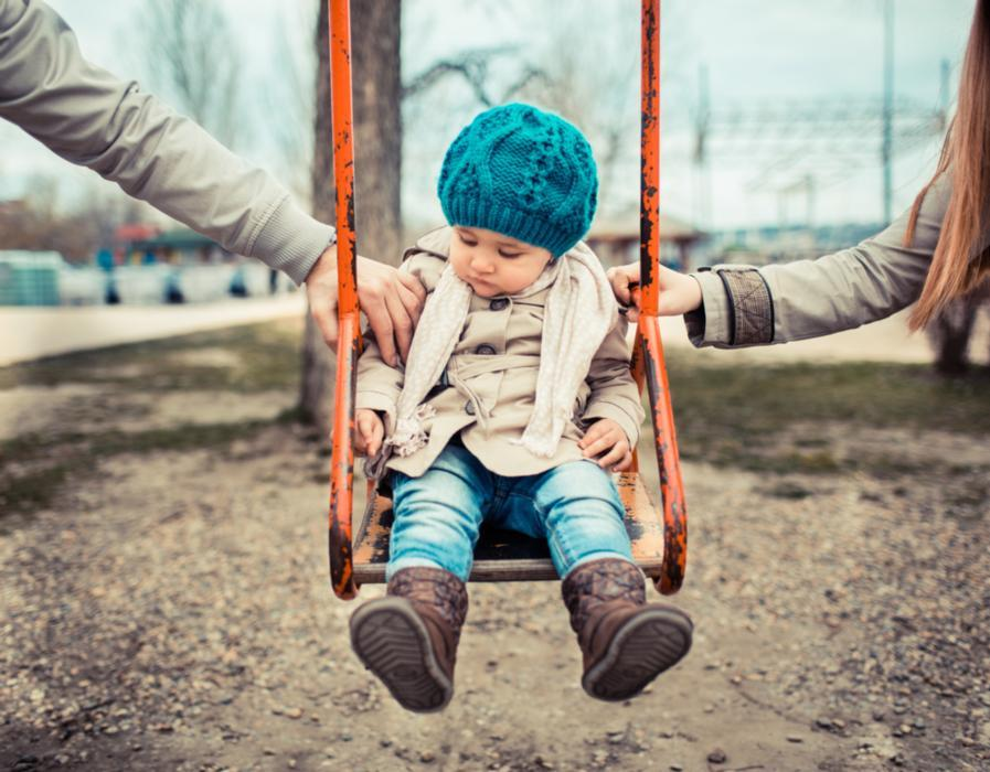 A child sits in a swing | children's dentist arlington tx