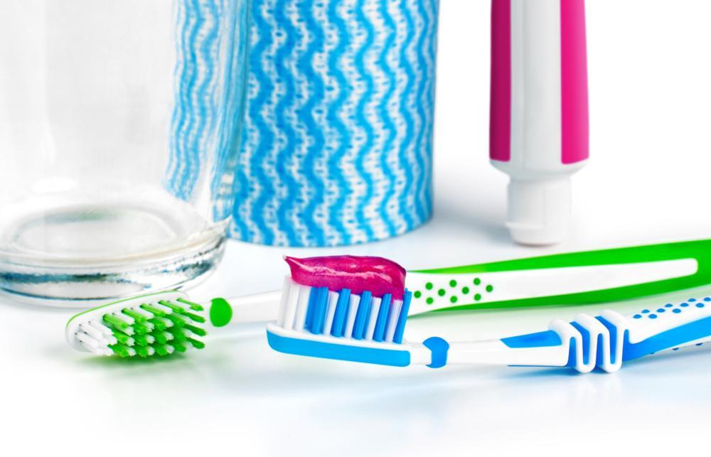 A toothbrush and toothpaste on a white backdrop | Gum Health Arlington TX