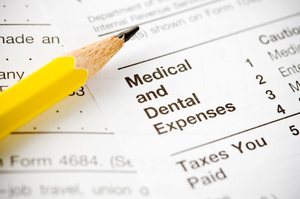 An image of a pencil on top of insurance papers | dental practice arlington tx