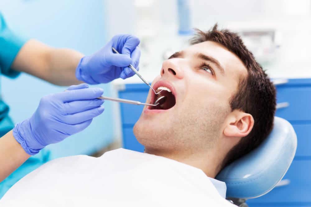 man getting dental exam