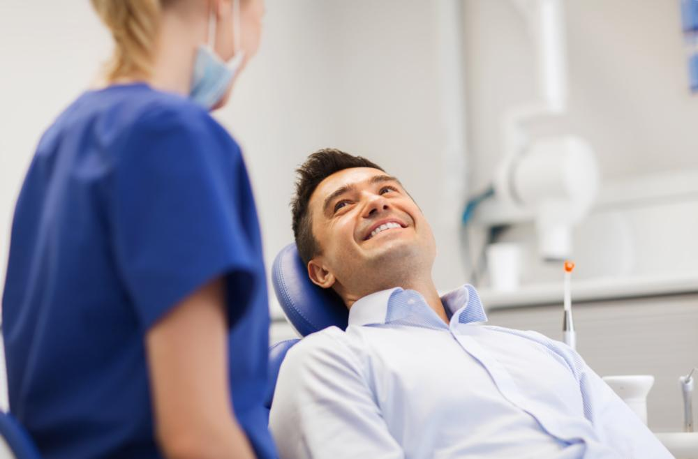 A man smiles In the dental chair | Snap on Smile Arlington tx