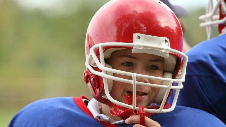 Young football player wearing a mouth guard